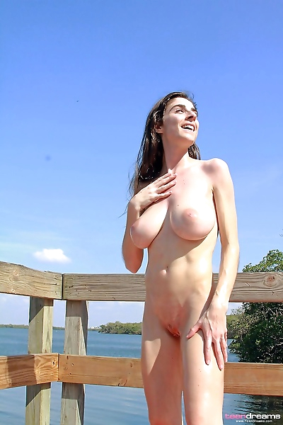Nude female covers up her..