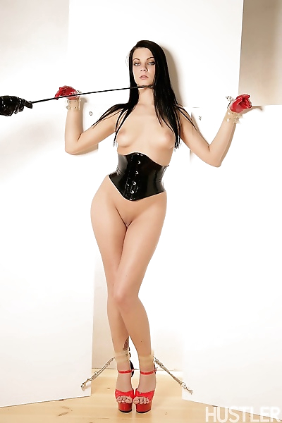 BDSM babe in latex with whip..