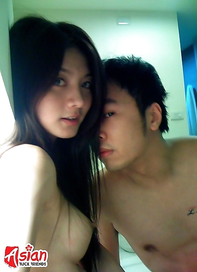 Young asian teen sucking..
