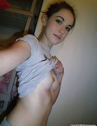 Sexy coed Emily Grey takes a selfie of her small tits and bare bald pussy