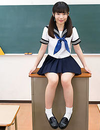 Tiny titted Japanese schoolgirl undressing to stand naked in the classroom