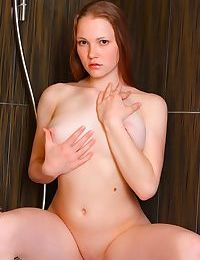 Young solo girl Nerila wets her pussy while relaxing in a bathtub