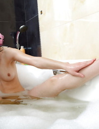 Cute brunette babe Nikita E playing with a big toy after shower
